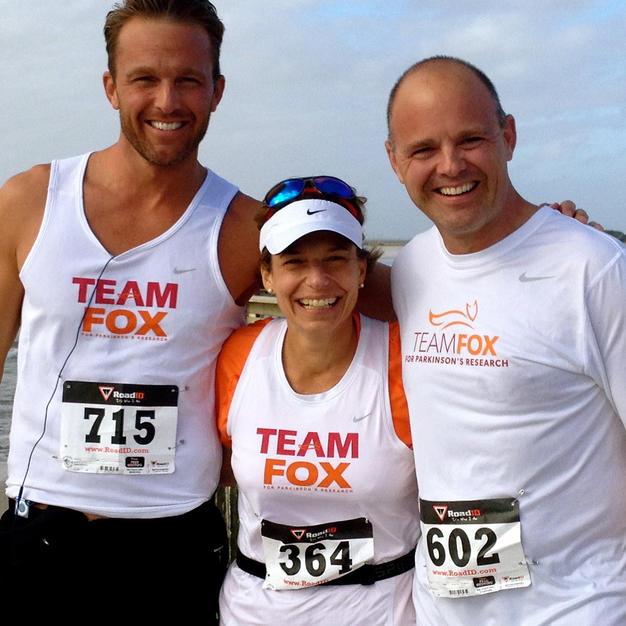 Three Team Fox athletes posing for camera on the beach.