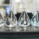 Four beakers in a research laboratory.