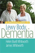 "Cover of book, ""A Caregiver's Guide to Lewy Body Dementia"" with a older Caucasian couple smiling."
