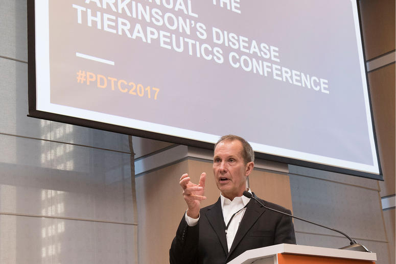 Male speaker at podium for the 2017 Parkinson's Disease Therapeutics Conference