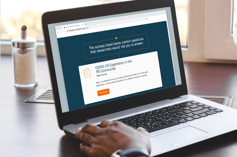 Hand of a person using a laptop.