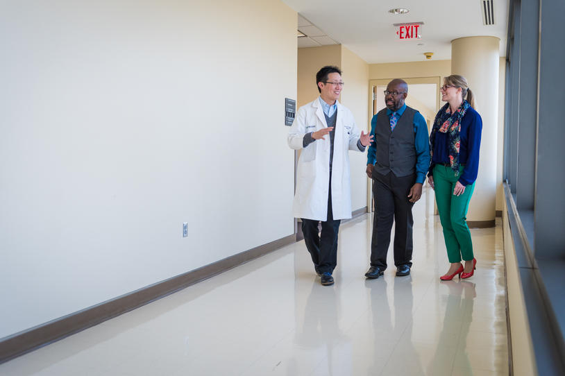 Doctor walking with patients.