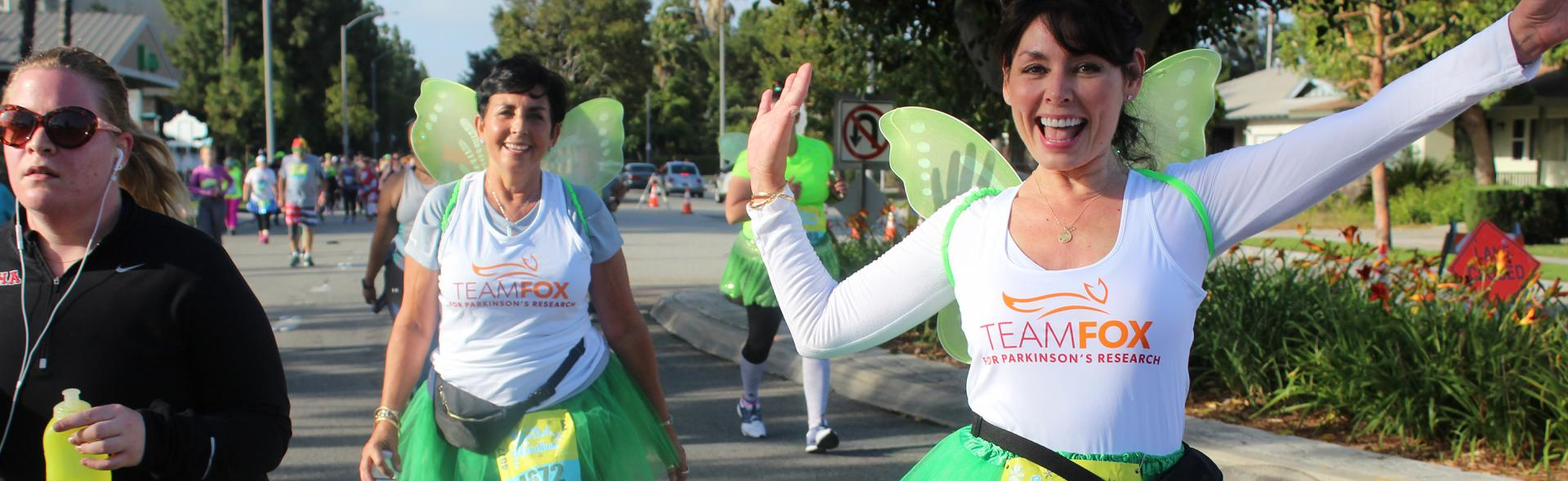 Two females in fairy costumes at a Team Fox event.